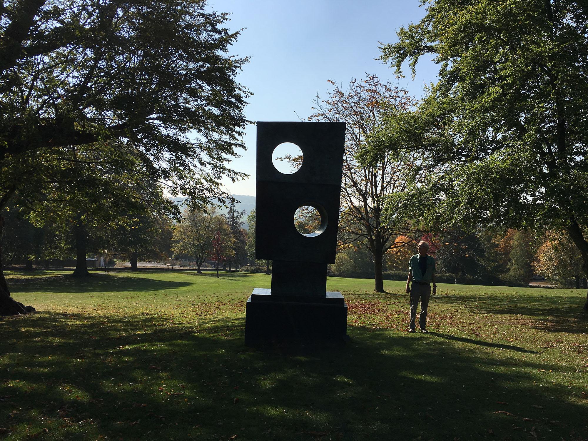 Jeremy Gardiner admiring a Barbara Hepworth sculpture